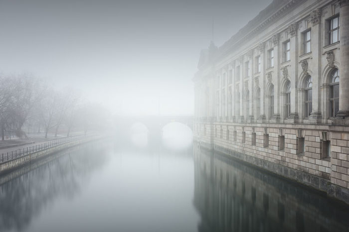 reflection of the bodemuseum in water on a foggy day Architecture Architecture Berlin Berlin Mitte Bodemuseum Bridge - Man Made Structure Built Structure City Day Fine Art Foggy Day Germany Long Exposure Misty Day Muted Colors Nature No People Outdoors Philipp Dase Sightseeing Sky Spree River Berlin Travel Destination Urban Icon Discover Berlin HUAWEI Photo Award: After Dark