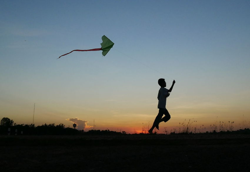 Children playing kites in sunset background. Happy Kite Running Sunset_collection Chidren Clear Sky Day Full Length Leisure Activity Lifestyles Nature Outdoors Play Real People Silhouette Sky Sport Sportsman Sun Sunset Mix Yourself A Good Time