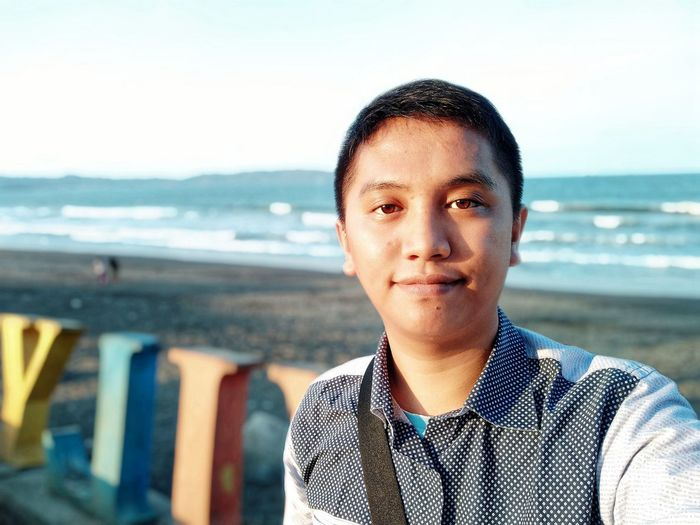 Portrait of young man on beach