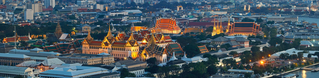 Bangkok city Overview with Grand Palace, Temple of the Reclining Buddha landmark of Bangkok Architecture Building Exterior City Built Structure Cityscape Building High Angle View Crowded Travel Destinations Crowd Residential District Illuminated Religion Roof Dusk Night Landscape Place Of Worship Outdoors Skyscraper Office Building Exterior