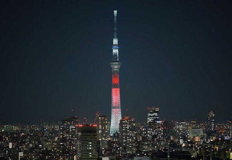 Illuminated tokyo sky tree in city against clear sky