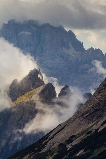 Idyllic shot of dolomites in foggy weather