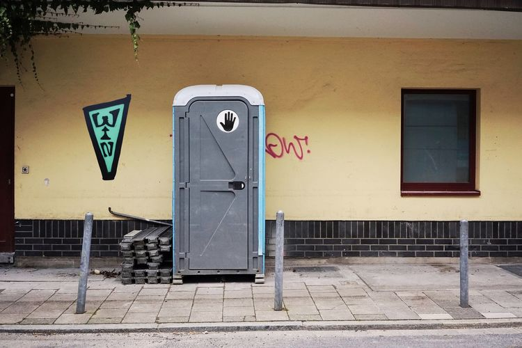 Building Site Toilet Architecture Built Structure Building Exterior No People Graffiti Wall - Building Feature Day Sign Communication Text Door Building Abandoned Public Building Closed Outdoors Creativity