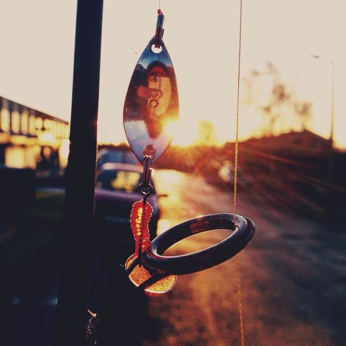 Fishing lure sunrise shadows Fishing Lure Lures Fishing Sunset Sunrise Hanging Focus On Foreground No People Metal Close-up Outdoors Day First Eyeem Photo