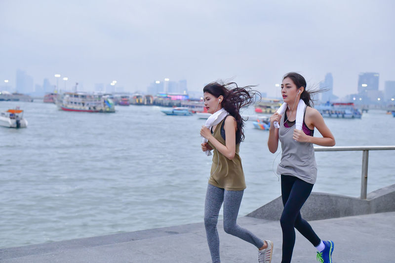 Terrestrial Sports Active Activities Activity Asian  Athlete Blue Boardwalk Chinese Clothes Endurance Exercise Exert Female Fitness Freedom Game Girl Happiness Happy HEAL Health Healthcare Healthful Healthy Japanese  Jogger Korean Legs Lifestyle Morning Motion Ocean person Relax Relaxation Runner Running Sea Seaside Sky Sports Stamina Trail Training Vitality Walking Warm Up Woman Young