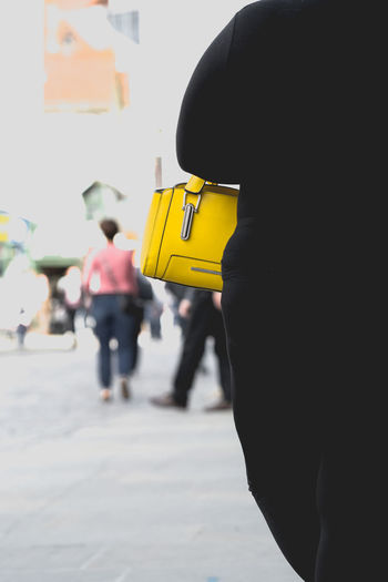Large woman in black cloths with small yellow handbag England, UK Everyday Life Paint The Town Yellow Shopping Woman Black Black And Yellow  Built Structure City Comic Complex Day Fat Grotesque Handbag  One Person Oversize People Real People Rear View Size Xxl Street Town Xxl Size Yellow