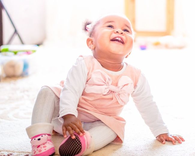 Childhood One Person Child Sitting Smiling Cute A New Perspective On Life Indoors  Happiness Leisure Activity Emotion Innocence Women Lifestyles Baby Full Length Females Girls Toy Young