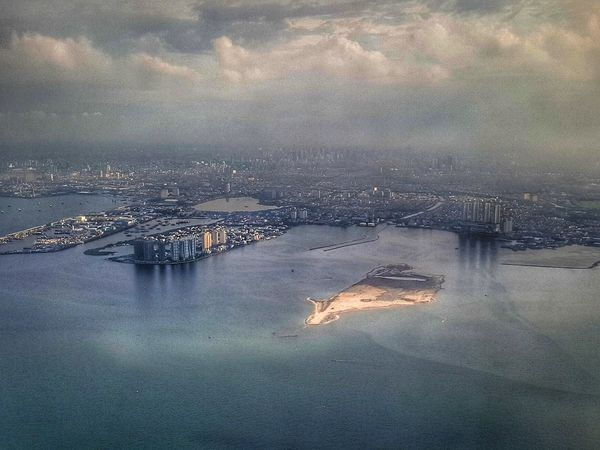 Inflight photo: Jakarta Water Reflection Sky No People Outdoors Waterfront Nature Sea Cityscape Architecture Airplane Snapseed HRD Effects Landscape Exterior Architecture City View From The Top View From Above Birds Eye View Snapseed Edit Nature Calm Water Jakarta Shoreline