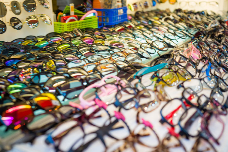 Glasses in a night market in Taipei Glasses Spectacles Abundance Arrangement Business Choice Close-up Collection Consumerism For Sale High Angle View Indoors  Large Group Of Objects Market Market Stall Multi Colored No People Retail  Sale Selective Focus Still Life Store Table Variation