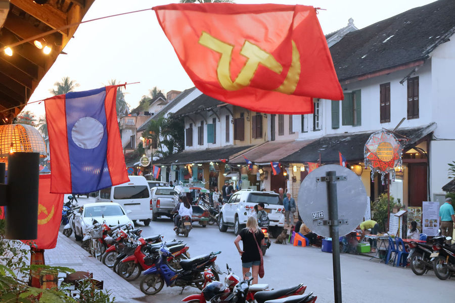 Architecture Building Exterior Built Structure City Crowd Day Flag Laos Large Group Of People Lifestyles Luang Prabang Men Outdoors People Real People Red Women