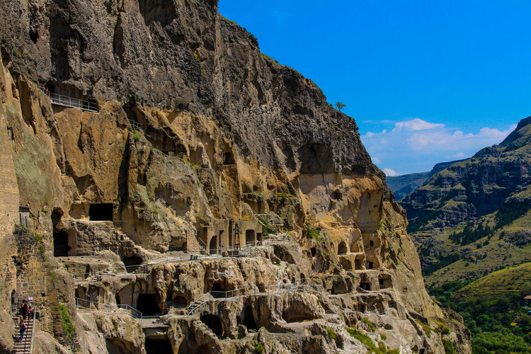 Ancient Civilization Archeology Beauty In Nature Cliff Day Georgia Historical Sights Landscape Low Angle View Mountain Mountain Range Nature No People Outdoors Rock - Object Rock Face Rock Formation Scenics Sky Summer Travel Destinations Vardzia