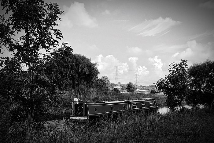 Canal Barge Tranquil Scene Solitude Water Sailing Afloat Cruising Relaxing Countryside Non-urban Scene Outdoors Beauty In Nature Remote Blackandwhite