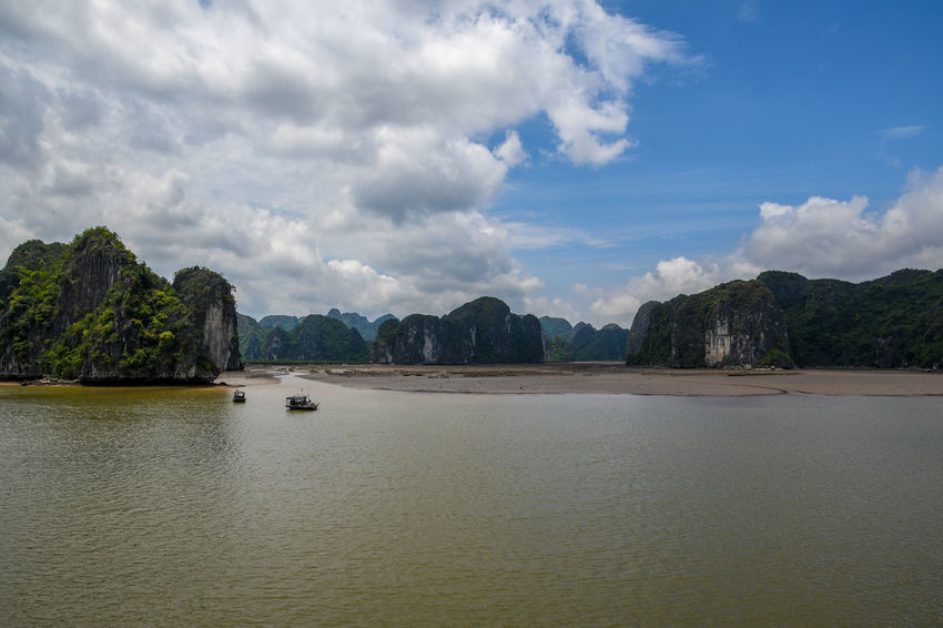 Halong Bay Vietnam Beauty In Nature Cloud - Sky Day Idyllic Land Mountain Nature Nautical Vessel No People Non-urban Scene Outdoors Scenics - Nature Sea Sky Tranquil Scene Tranquility Tree View Into Land Water Waterfront