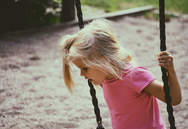 Girl swinging at playground