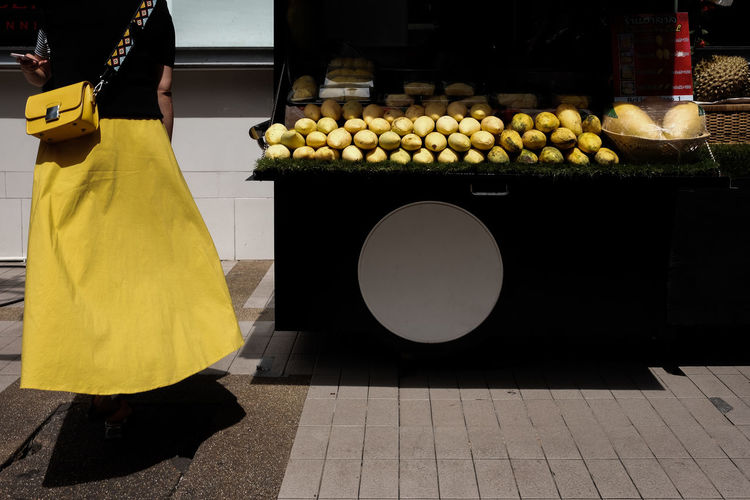 Rear view of woman standing at market stall