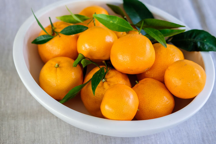 Mandarins Bowl Citrus Fruit Close-up Day Food Food And Drink Freshness Fruit Healthy Eating Indoors  Leaf Mandarin Mandarins No People Orange Orange Color Plate