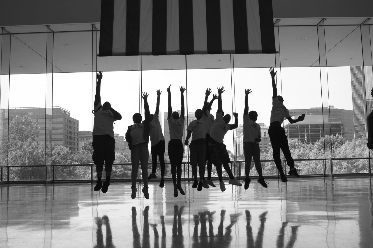 GROUP OF PEOPLE ON GLASS WINDOW