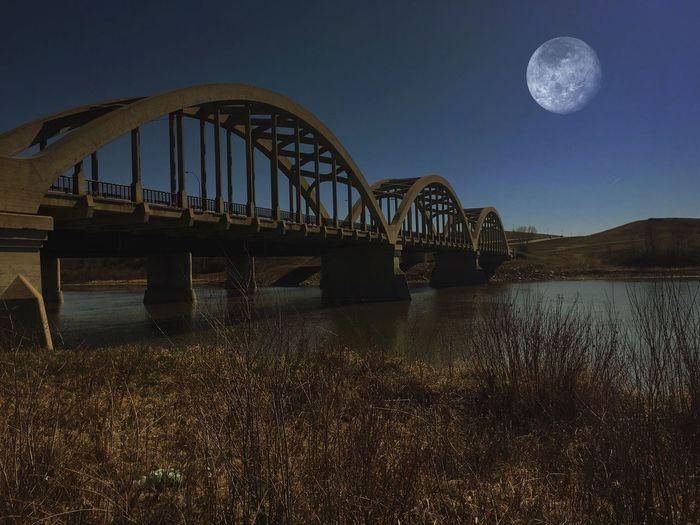 Arched bridge over calm lake