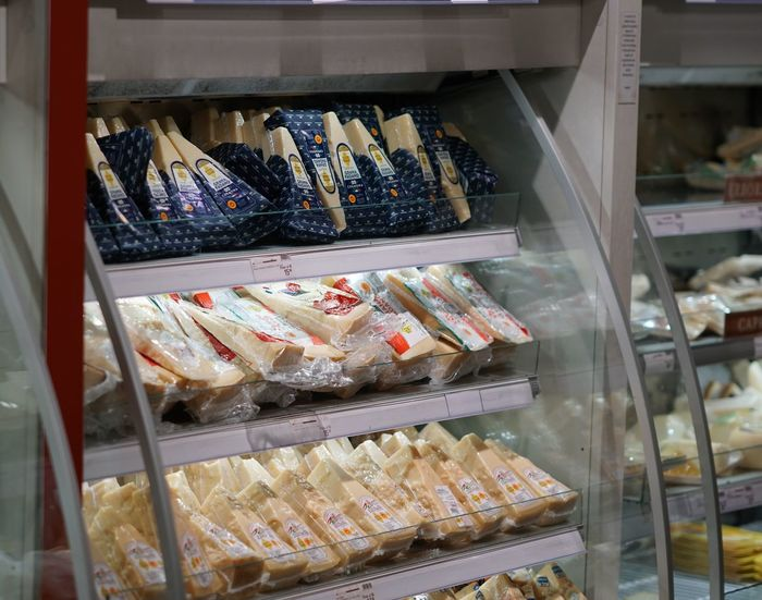 Italian traditional cheese in showcase Check This Out Italian Cuisine Dairy Product Food For Sale Grana Padano Italian Culture Milk Products Parmigiano Reggiano Parmigianoreggiano Traditional