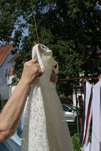 Bride Dress Casual Clothing Close-up Cropped Day Focus On Foreground Hands At Work Hands In The Air Holding Leisure Activity Lifestyles Outdoors Part Of Personal Perspective Skill  Tree Unrecognizable Person