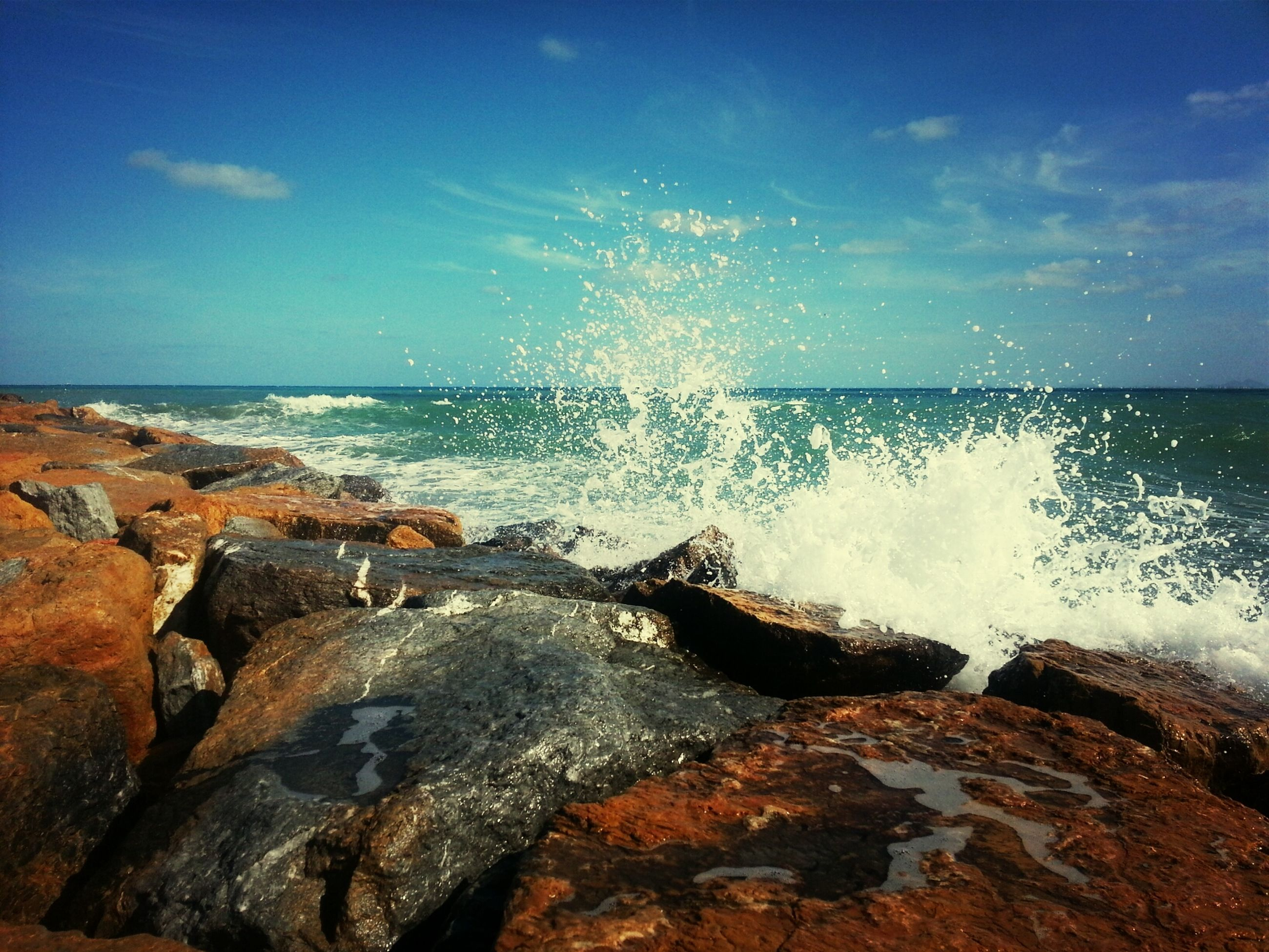 water, sea, horizon over water, scenics, beauty in nature, rock - object, sky, motion, wave, splashing, surf, nature, tranquil scene, shore, beach, tranquility, rock formation, idyllic, blue, power in nature