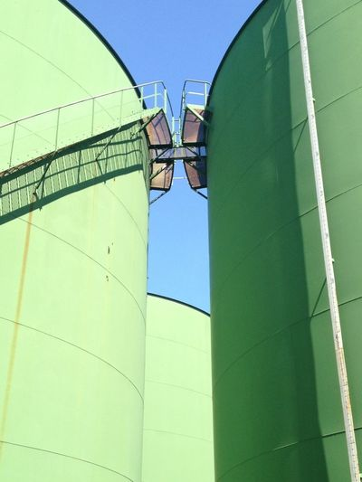 Low angle view of staircase at fuel storage tank