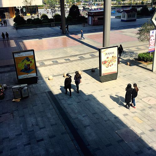 Light And Reflection Real People High Angle View Sunlight Walking Men Women City Life Outdoors City Adults Only People Day Adult