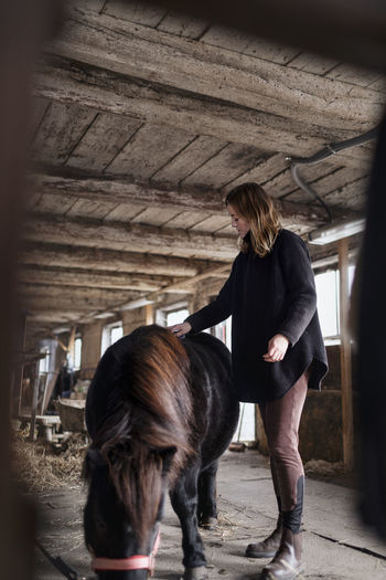 Woman standing in stable