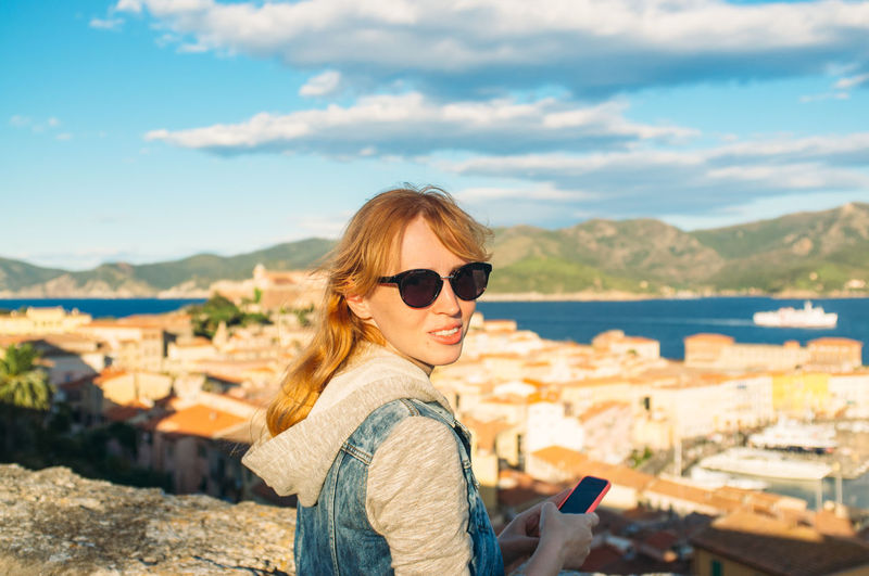 Portrait of Young Woman With Townscape In Background