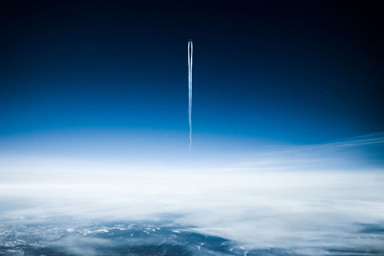Cloud - Sky Sky Vapor Trail Blue Space Flying No People Air Vehicle Nature Motion Transportation Space Exploration Day Airplane Beauty In Nature Outdoors Mid-air Speed Cloudscape Copy Space Aerospace Industry