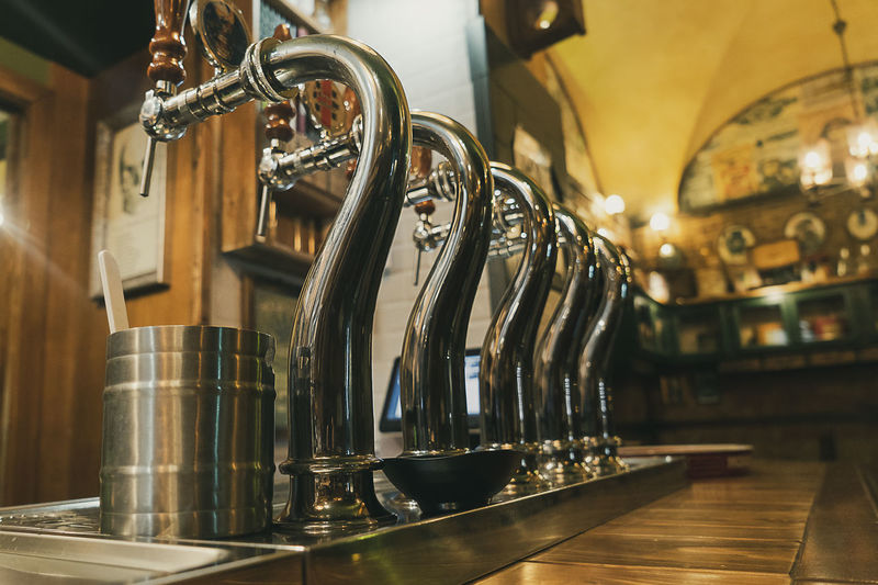 Draft beer staplers, inside view of a nightclub. Bar - Drink Establishment Bar Counter Beer Tap Close-up Coffee Shop Craft Beer Distillation Drink Focus On Foreground Food And Drink Food And Drink Industry In A Row Indoors  No People Refreshment Restaurant Wood - Material
