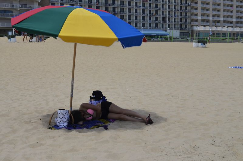 Beach Beach Life Beach Umbrella Blue Casual Clothing Day Enjoyment Full Length Leisure Activity Lifestyles Lying Down Outdoors Parasol Relaxation Relaxing Relaxing Resting Sitting Summer Summertime Tourist Umbrella Vacations Virginia Beach Woman Miles Away Women Around The World Live For The Story Breathing Space Done That. Connected By Travel