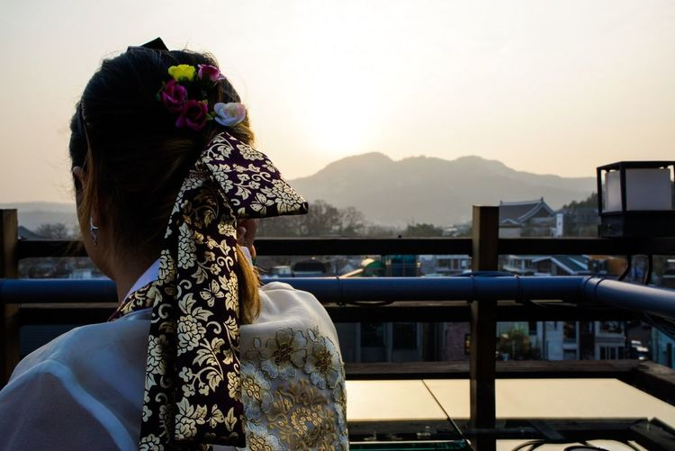 Rear View Of Woman In Traditional Korean Clothing