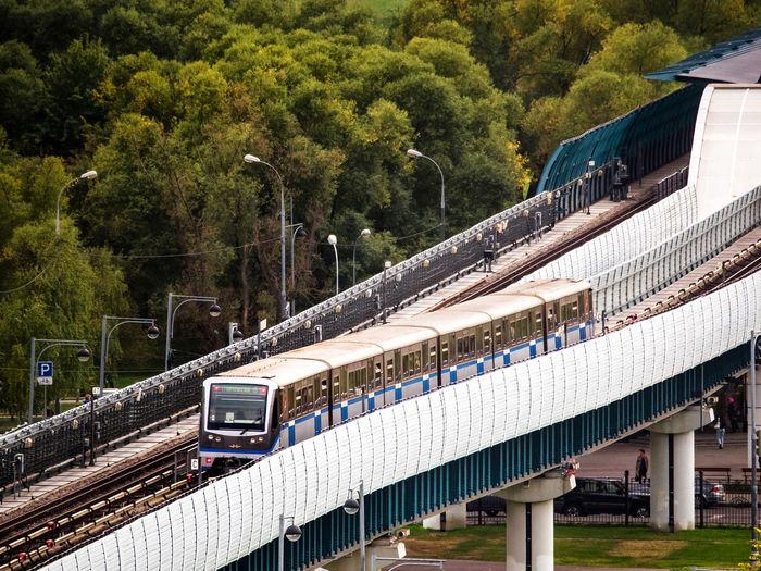 High angle view of metro train on bridge