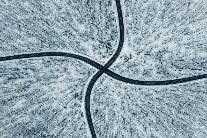 Aerial view of road intersection in the forest at winter. Drone shot Aerial View High Angle View No People Nature Transportation Mode Of Transportation Environment Beauty In Nature Outdoors Backgrounds Snow Travel Landscape Roads Intersection Aerial Intersection Winter Forest Winter Wonderland Winter Trees Crossroads Journey Symmetry Snowy Trees Drone