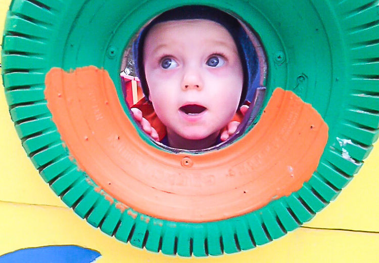 Close-up of boy playing in playground
