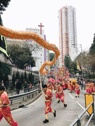 Different religions coexist in one society. Parade Dragon Dance Religion And Tradition Religious Festival Religion Taoism Festival Traditional Clothing Traditional Festival Tradition Chinese Culture Chinese Dragon Cultures Large Group Of People Coexist Teamwork