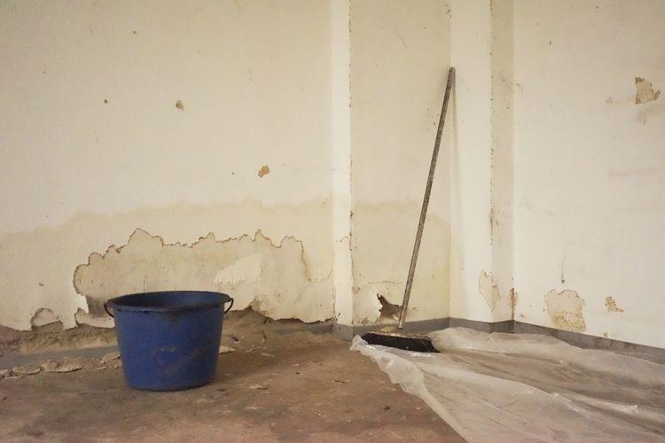 Mop and bucket in empty room