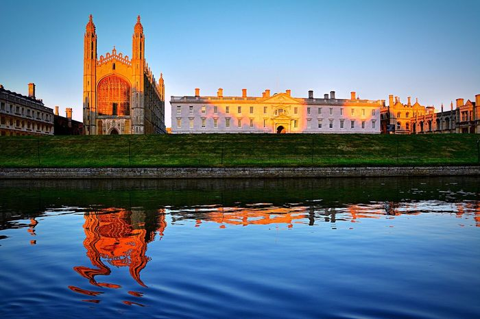 King's College King's College, Cambridge King's College Chapel Chapel Cambridge Architecture Building Exterior Water Built Structure Reflection Waterfront Spirituality Religion Place Of Worship Travel Destinations Clear Sky Church Tourism Famous Place Blue Outdoors Riverbank Water Reflections
