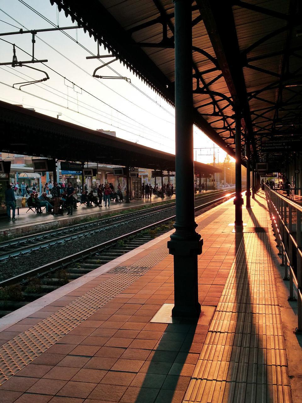 RAILROAD STATION PLATFORM SEEN THROUGH TRAIN AT RAILWAY