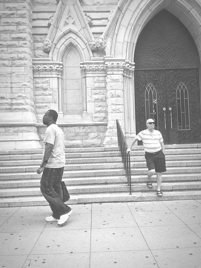Two People Standing Walking Place Of Worship Church Cathedral Outdoor Photography Streetphotography Blackandwhite Diversity Different Architecture People B & W  Blackandwhite Photography Real People Candid Candid Photography Meaningful  Message Men Chicago Walks