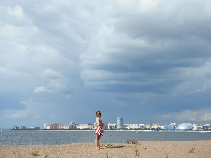 Beach view the gulf of finland clouds and city
