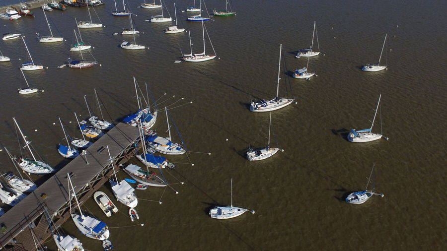 High angle view of boats moored in row