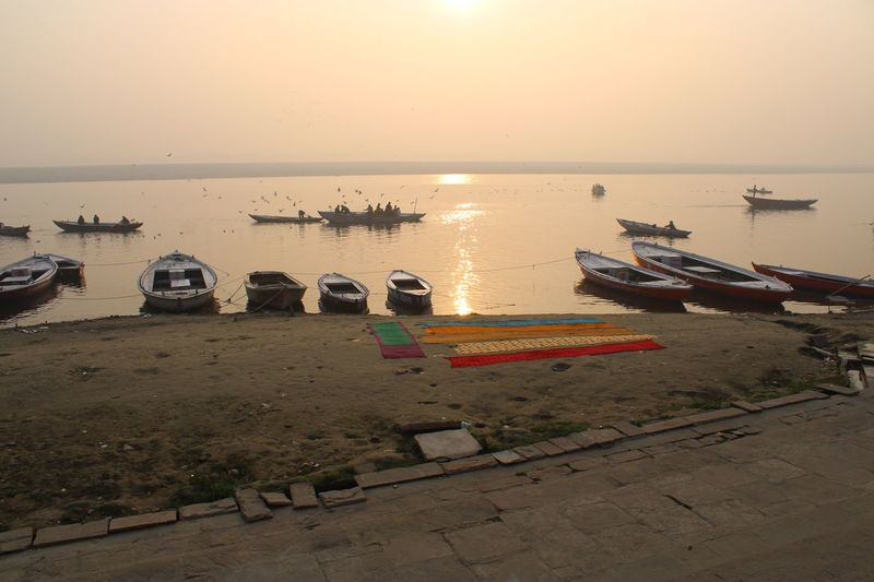 Sunrise over the Ganges, people feeding the birds beautiful & serene River Scenes Water Sky Nautical Vessel Transportation Mode Of Transportation Horizon Over Water Beauty In Nature Incidental People Tranquility Scenics - Nature