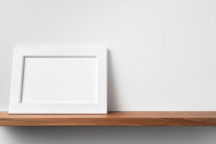 High angle view of white curtain on table against wall