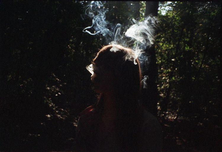 Dark Habit Analogue Photography Film Smoke Smoking Sunlight Leisure Activity Nature One Person Outdoors People Women