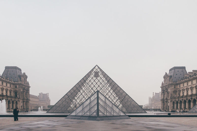 Architecture Building Exterior Built Structure Day France History Louvre Museum Outdoors Paris People Pyramid Pyramid Shape Sky Tourism Travel Travel Destinations