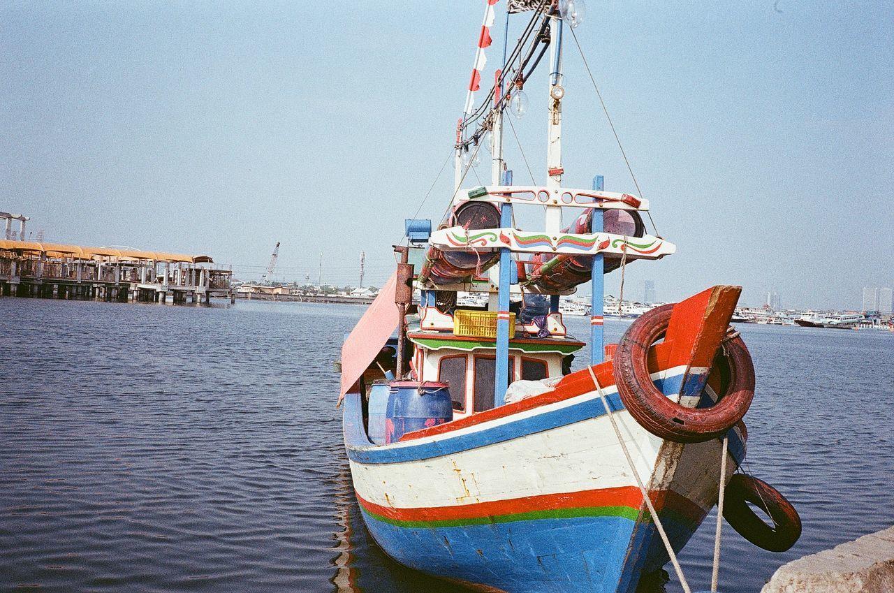 FISHING BOATS MOORED IN SEA