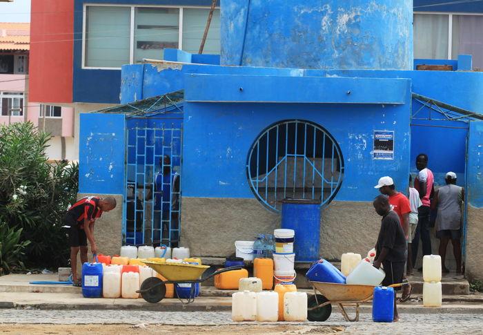 Blue Capo Verde Day Full Frame Shot Full Length Outdoors People Plastic Pails Public Fountain Sal Island Santa Maria Street Photography Summer 2015 Wheelbarrows Women
