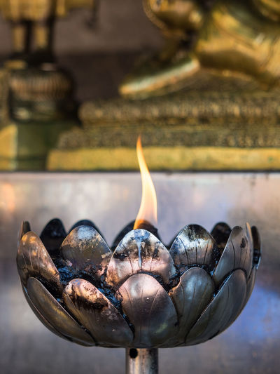 Close-Up Of Burning Oil Candle In Buddhist Temple, Chiang Mai, Thailand